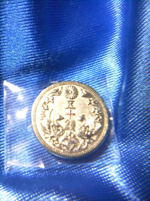��(i150)『日本の貨幣コレクション』�bU 八咫烏五十銭銀貨(レプリカ)です。